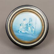 A 19th century ivory mounted horn snuff box Of circular form,