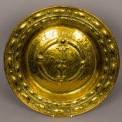 An 18th century brass alms dish Of typical circular dished form,