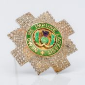 An early 20th century unmarked white and yellow gold diamond and amethyst set enamel decorated