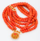 A four strand coral bead necklace Set with an 18 ct gold clasp. Approximately 36 cm long.