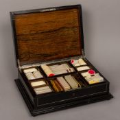 A 19th century Continental ivory inlaid ebony games box The inlaid hinged top enclosing the fitted