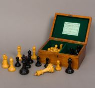 A Victorian Jacques of London boxwood and ebony Staunton pattern chess set Housed in original box,