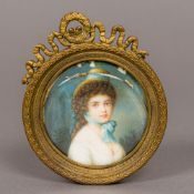 A 19th century portrait miniature on ivory Depicting a young girl wearing a hat and blue neck scarf,