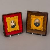 A pair of Victorian miniature portraits on ivory One depicting a young lady wearing a brooch and a