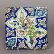 An antique Iznik tile Typically decorated with floral motifs. 16.25 cm square.