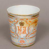 A late 19th century Russian enamel beaker Commemorating Czar Nicholas II and dated 1896. 10.