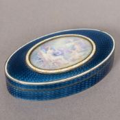 A Russian enamel decorated silver box Of oval form,
