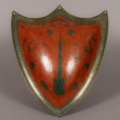 A 19th century Indian copper shield The red and blue enamel ground with scrolling foliate