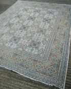A Persian wool carpet Centred with floral motif filled geometric panels. 315 x 260 cm.