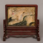 A Chinese hardstone inset wooden table screen The removable screen decorated to one side with