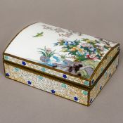 A cloisonne box The domed hinged lid decorated with floral sprays on a rocky outcrop and a bird in