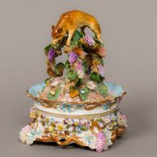 A 19th century Meissen porcelain lidded desk stand The removable cover decorated with fruiting