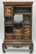 A Japanese Meiji period shibyama and lacquer decorated shodhana cabinet Of typical form,