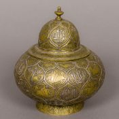 An antique Islamic unmarked silver inlaid brass jar and cover Of squat ovoid form,
