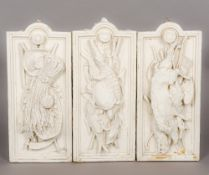 Three 19th century painted plaster relief plaques One formed as a turtle,