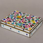 A Japanese cloisonne box Of hinged rectangular form, the lid decorated with various floral sprays.