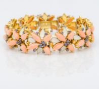 An 18 ct gold coral, sapphire and enamel bracelet The links of floral form. 17.5 cm long.