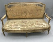 A 19th century French tapestry upholstered giltwood settee The florally upholstered padded back