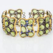 An unmarked yellow and white metal bracelet Set with peridots,