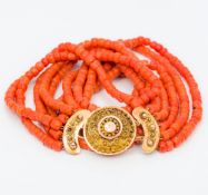 A five strand coral bead necklace Set with an 18 ct gold clasp. Approximately 43 cm long.