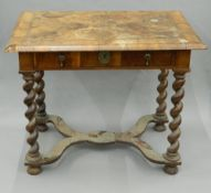 An 18th century walnut side table The moulded feather banded quarter veneered rounded rectangular