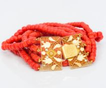 A four strand coral bead necklace Set with an 18 ct gold filigree clasp. 35 cm long.