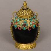 A Tibetan hardstone snuff bottle The gilt metal mounts set with turquoise and other stones.