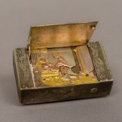 A 19th century Continental unmarked white metal secret erotic automaton vesta case The hinged panel