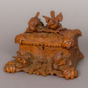 A late 19th century Black Forest carved wooden jewellery casket Of naturalistic form,