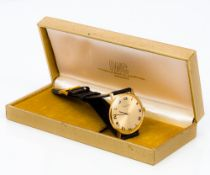 A 9 ct gold International Watch Co (IWC) gentleman's wristwatch The golden dial with Roman numerals,