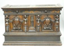 A 16th century Renaissance oak and walnut marriage chest With arcaded panels and two carved