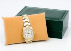 A gentleman's Rolex oyster perpetual date wristwatch The white dial with batons and Roman numerals