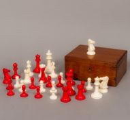 A Victorian ivory and red stained ivory Staunton pattern chess set Housed in a mahogany box.