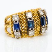 An unmarked gold diamond and sapphire set ring - WITHDRAWN Of rope twist form,