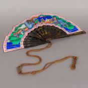 A 19th century Chinese canton fan With lacquered guards,