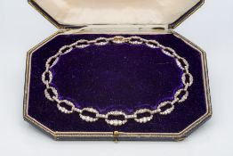 A Victorian/Edwardian unmarked gold diamond set necklace Of oval link form,