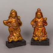 A pair of Oriental gilt heightened lacquered stone carvings Each formed as a deity modelled on a