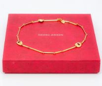 An 18 ct gold Georg Jensen necklace Housed in a plush lined Georg Jensen box. 44.5 cm long.