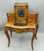 A Victorian ormolu mounted inlaid burr walnut bonheur du jour The back section with central