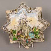 An antique Persian tile Of star form, decorated with a warrior. 30 cm wide.
