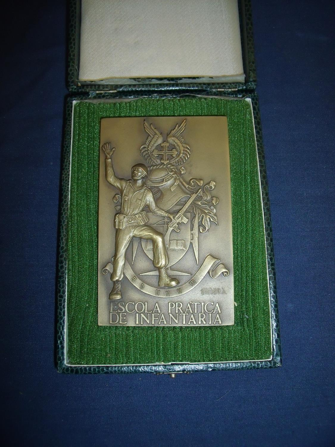 Lot 23 - Cased Portuguese Infantry bronze plaque with inscription to the back for The Royal Army Education