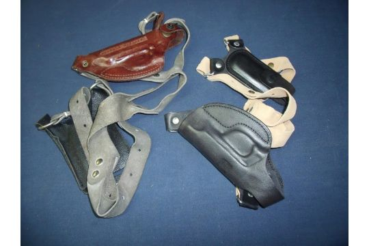 Two shoulder holsters for a Walther PP/PPK Pistols (one