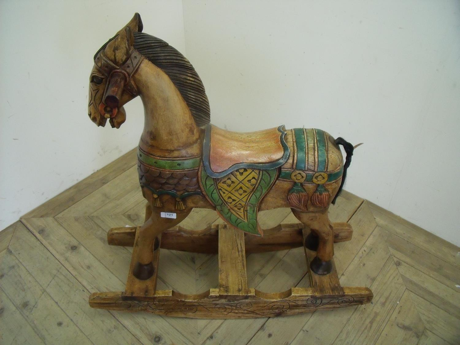 Lot 121 - Carved wood eastern style rocking horse (88cm high)