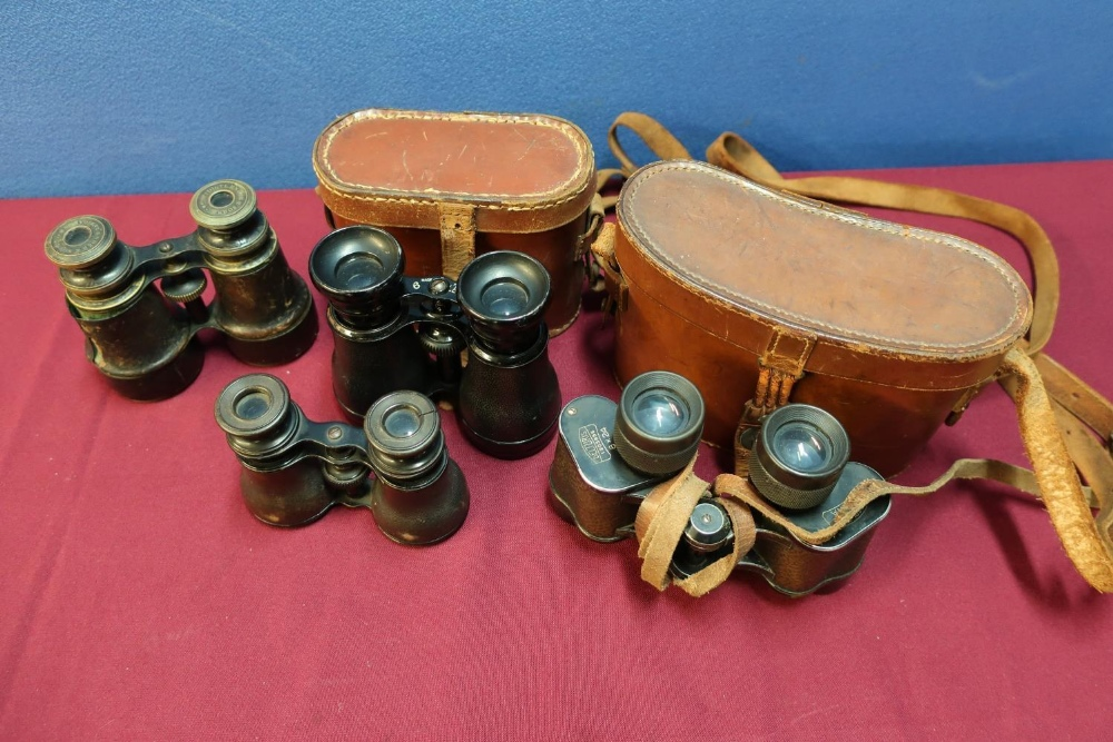 Lot 28 - Four various pairs of binoculars, two with leather cases, early-mid 20th C including French and Carl