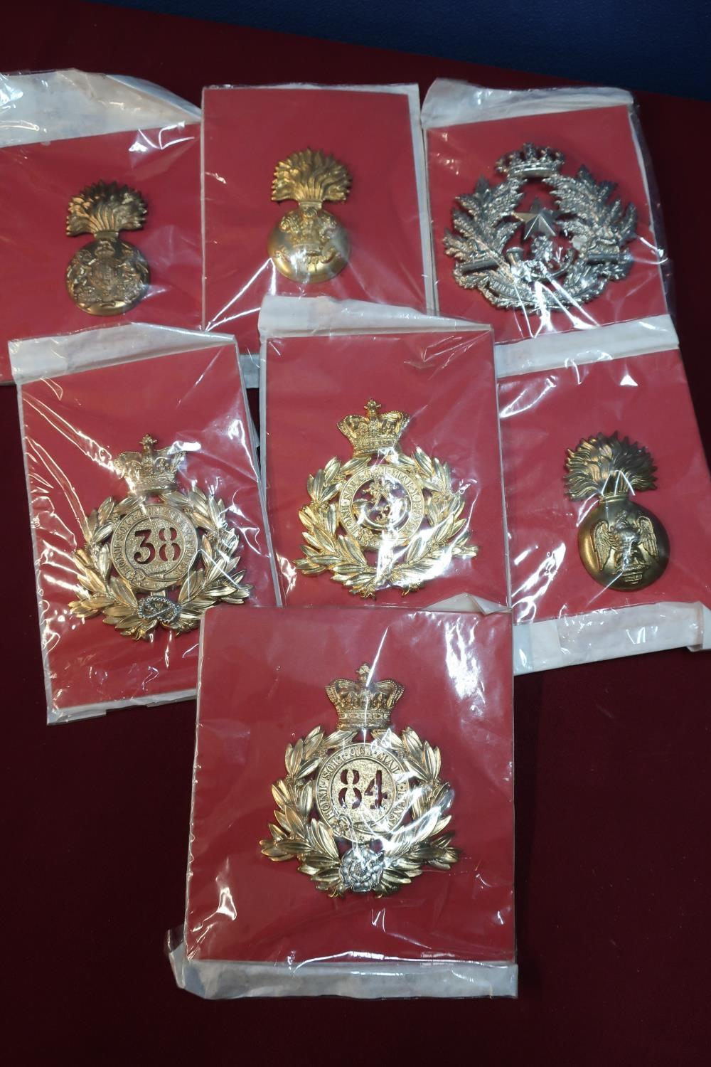 Lot 42 - Seven mounted large quality reproduction Victorian cap badges