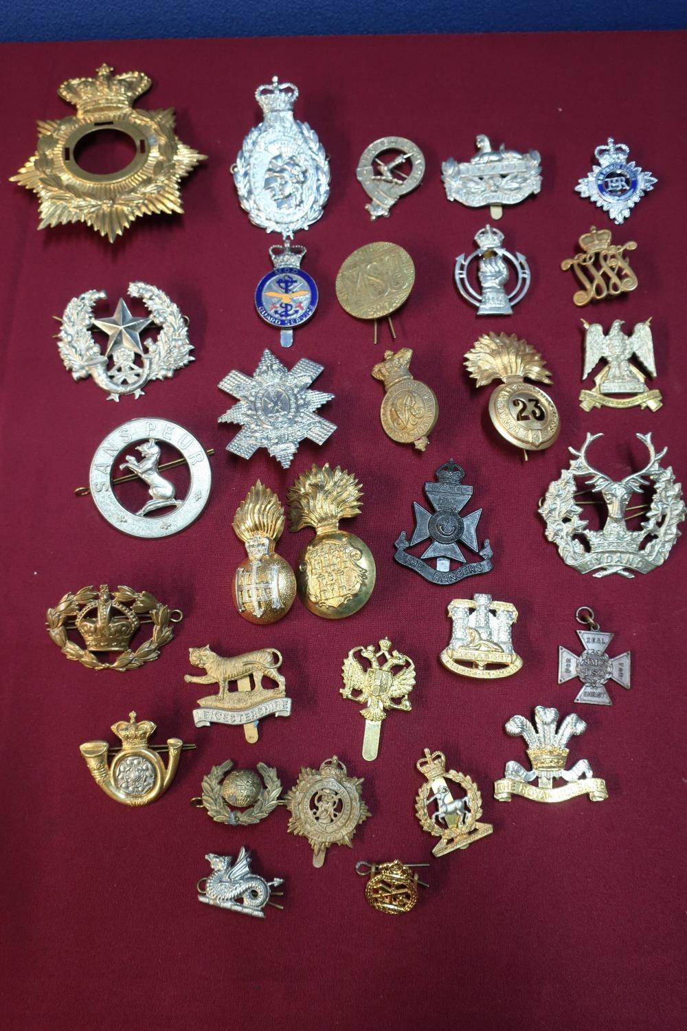 Lot 14 - Box containing a quantity of various military cap badges, mostly staybright, for various regiments