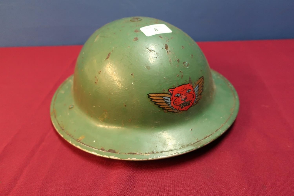 Lot 8 - Circa WWII British steel helmet with liner and webbing chin strap with painted Decel