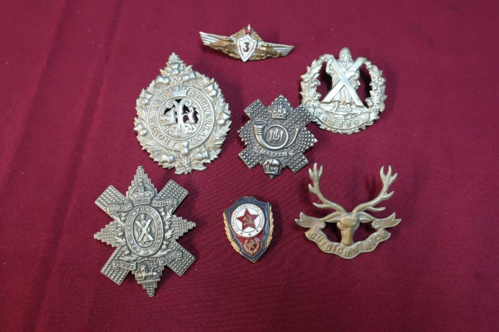 Lot 22 - Small selection of Scottish cap badges including Highland Light Infantry and two Soviet Union enamel