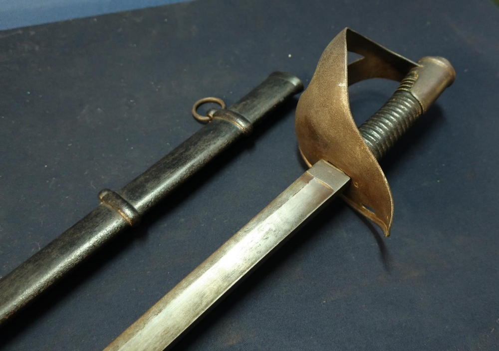 Lot 38 - 19th C Cavalry sabre with 35 inch single slightly curved fullered blade, stamped S and K, with