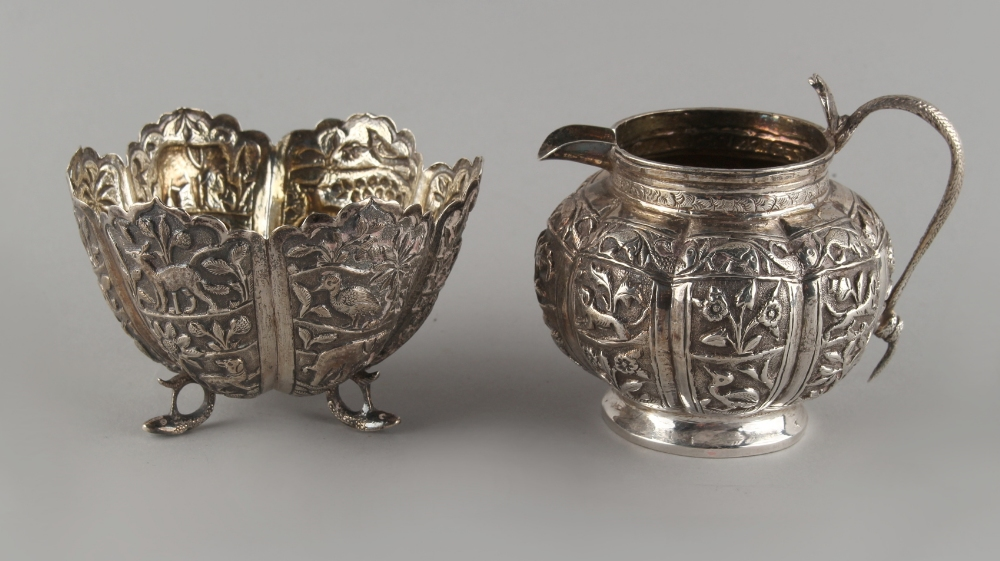 Lot 11 - Property of a lady of title - a late 19th / early 20th century Indian white metal cream jug and
